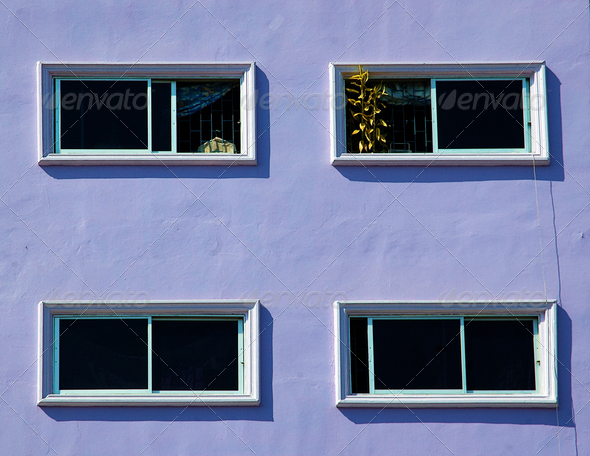 Windows on the purple wall. - Stock Photo - Images