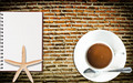 Coffee Cup and Notebook on the wall. - PhotoDune Item for Sale