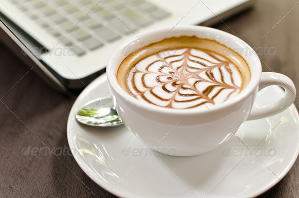 Coffee Cup on the wood with laptop. - Stock Photo - Images