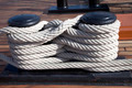 Old ropes around mooring bollard in a deck - PhotoDune Item for Sale