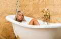 Tanned girl is lying in the bath - PhotoDune Item for Sale