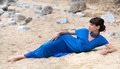girl in a dress lying on the sand - PhotoDune Item for Sale
