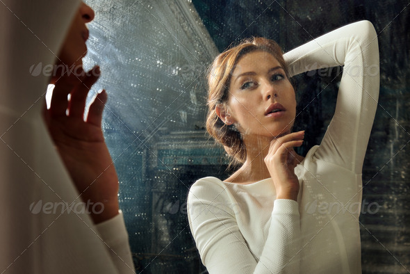 beautful woman in white dress at the mirror. - Stock Photo - Images