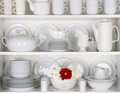 White Plates in Cupboard With a Basket of Roses - PhotoDune Item for Sale