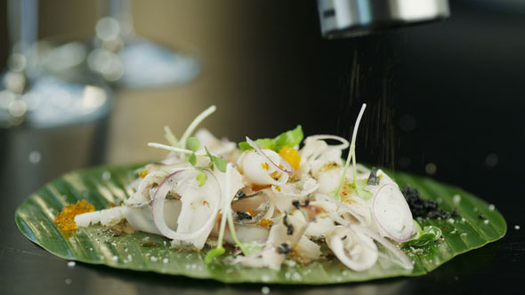 VideoHive Chef Seasoning Salad with Slices of Fresh Fish 4K 5560554