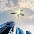 Airplane above city - PhotoDune Item for Sale