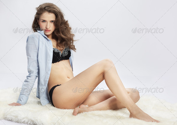 beautiful girl on furs - Stock Photo - Images