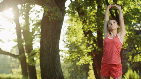 VideoHive Pretty Girl Stops for Stretch During Run 5636030