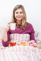 Happy woman with cup of coffee and breakfast - PhotoDune Item for Sale