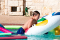 Cute boy climbing on tube in pool - PhotoDune Item for Sale