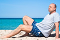 man sitting on the beach to relax - PhotoDune Item for Sale