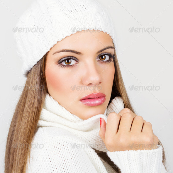 Gorgeous young woman with white winter hat and scarf - Stock Photo - Images
