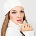 Gorgeous young woman with white winter hat and scarf - PhotoDune Item for Sale