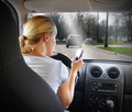Woman Texting on Phone and Driving Car - PhotoDune Item for Sale