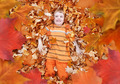 Boy Looking Up at Orange Autumn Fall Leaves - PhotoDune Item for Sale