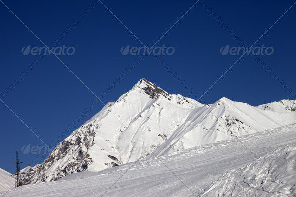 Ski slope and blue clear sky at sunny day - Stock Photo - Images