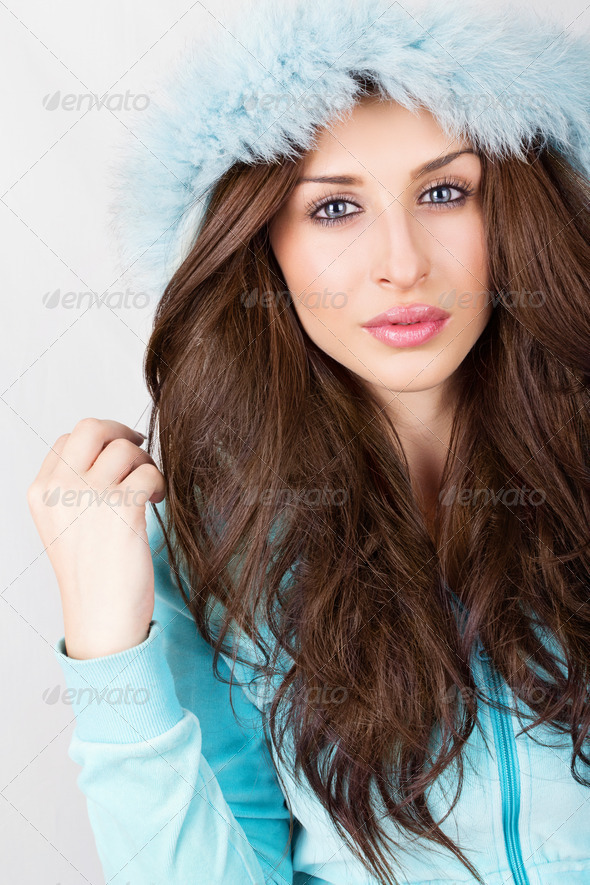Cute young student girl wearing fluffy blue hoodie - Stock Photo - Images