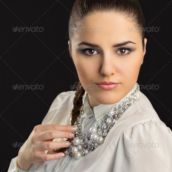 Gorgeous young stylish woman wearing modern necklace with pearls - Stock Photo - Images