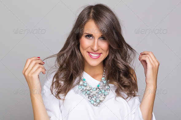 Beautiful casual woman wearing a fashionable necklace - Stock Photo - Images