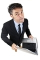 Pugnacious businessman holding a laptop - PhotoDune Item for Sale