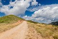 Path in mountains under dramatic sky - PhotoDune Item for Sale