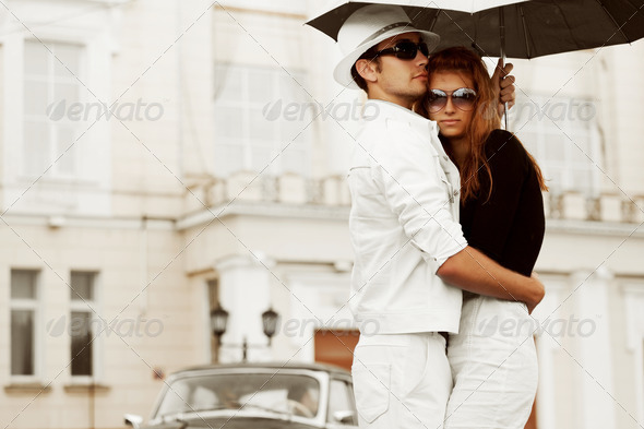 Young Couple With Umbrella - Stock Photo - Images
