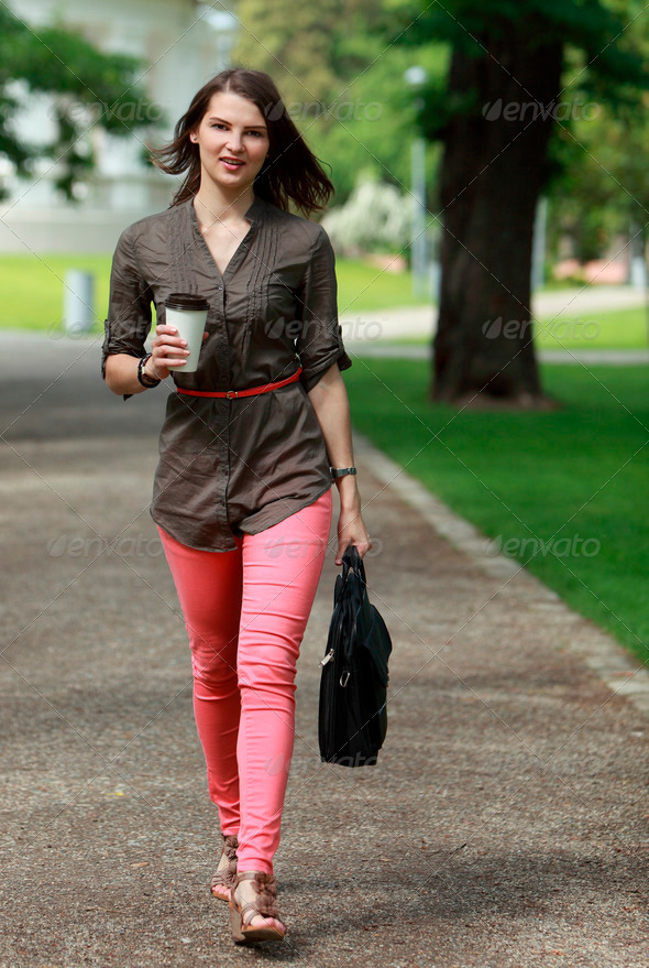 Young Woman in a Hurry - Stock Photo - Images