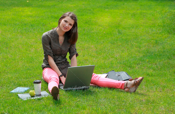 Young Woman with a Laptop in Grass  - Stock Photo - Images