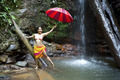 Girl with umbrella at waterfall - PhotoDune Item for Sale