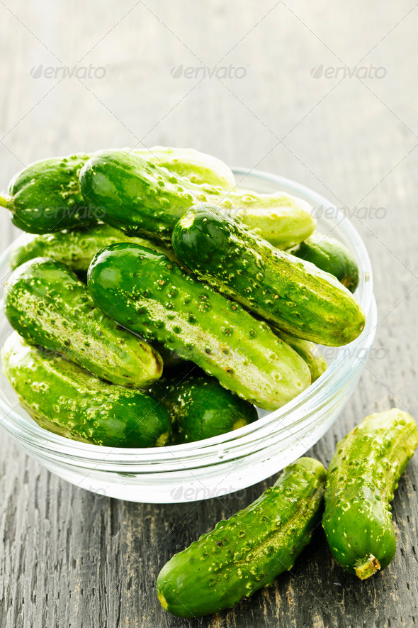Small cucumbers in bowl - Stock Photo - Images