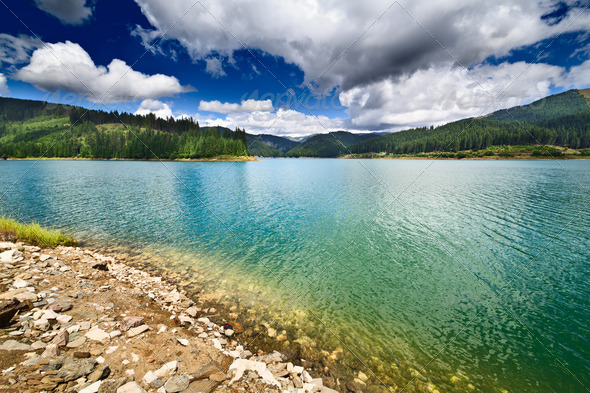 Dam Lake Bolboci in Bucegi mountains, Romania - Stock Photo - Images