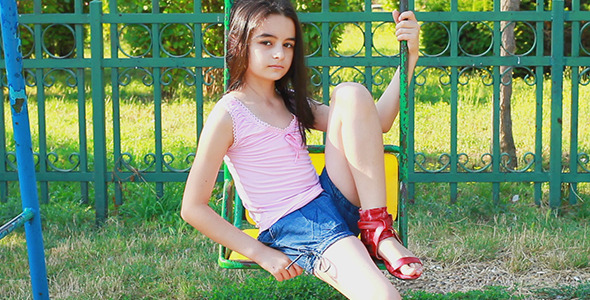 Sad Young Girl on Swing 1 - Stock Footage | VideoHive