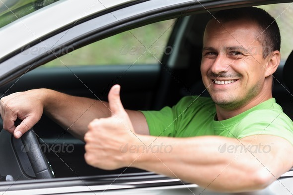 Happy young man with new car - Stock Photo - Images