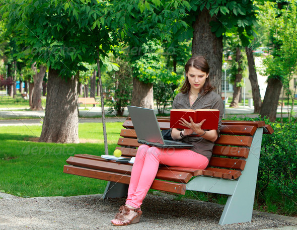 Young Woman Studying in a Park  - Stock Photo - Images