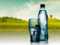 Spring mineral water bottled with glass and ice against natural - PhotoDune Item for Sale