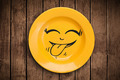 Happy smiley cartoon face on colorful dish plate - PhotoDune Item for Sale