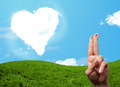 Happy smiley fingers looking at heart shaped cloud - PhotoDune Item for Sale