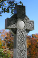 Decorated cross in cemetery during autumn - PhotoDune Item for Sale