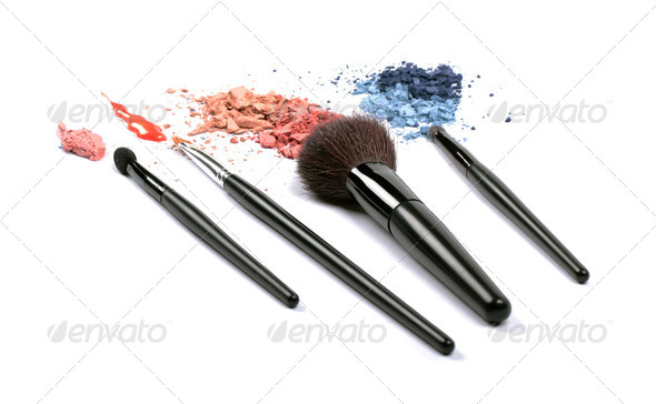 Cosmetic brushes, lip gloss and eyeshadows - Stock Photo - Images