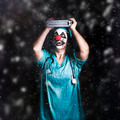 Crazy doctor clown laughing in rain - PhotoDune Item for Sale