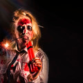 Evil female halloween zombie holding bomb - PhotoDune Item for Sale