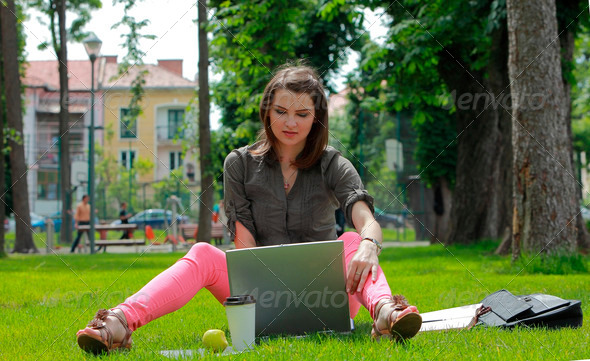Young Woman with Laptop in a Park  - Stock Photo - Images