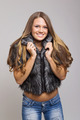 Attractive teenage girl wearing short fur coat smiling - PhotoDune Item for Sale