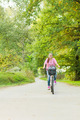 Student Girl Riding Bicycle Outdoor. - PhotoDune Item for Sale
