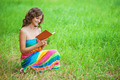 Portrait of beautiful woman holding book - PhotoDune Item for Sale
