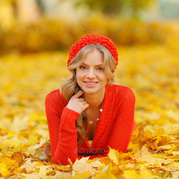 Woman laying on autumn leaves - Stock Photo - Images