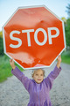 "little girl holding a red sign ""STOP"" - PhotoDune Item for Sale"