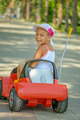 little girl riding toy car - PhotoDune Item for Sale