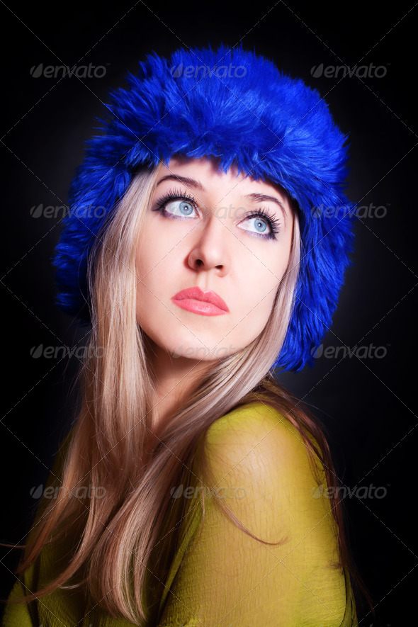 beautiful young woman in blue winter hat - Stock Photo - Images