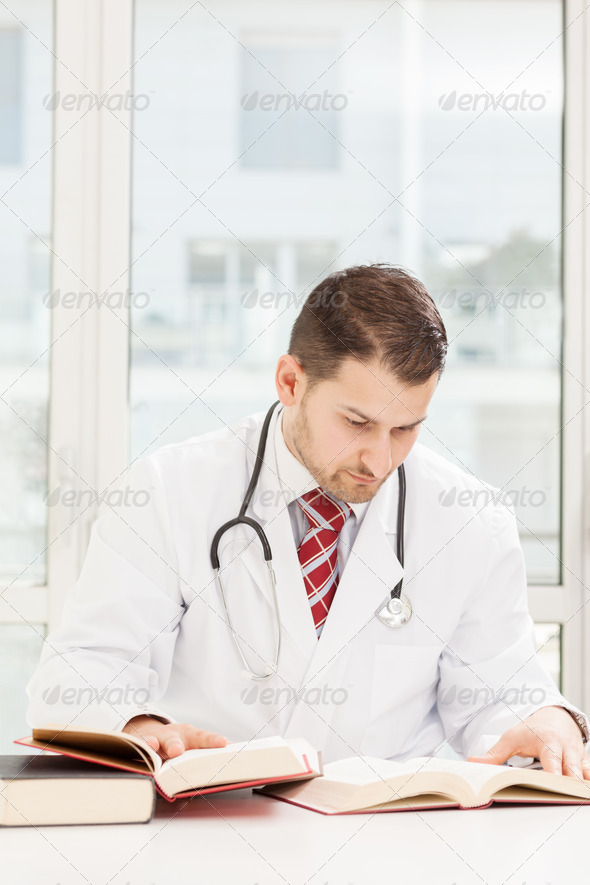 Male doctor is studying - Stock Photo - Images